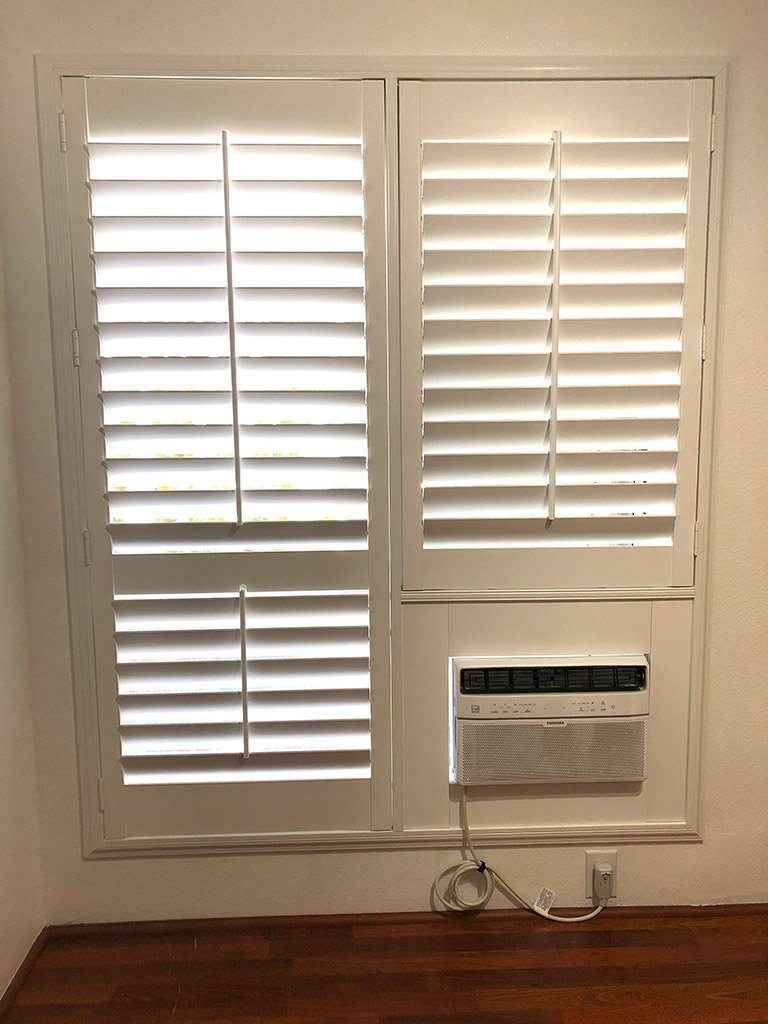 Shutter with AC fill piece for a complete finished look. All other companies just leave the ugly void as is.